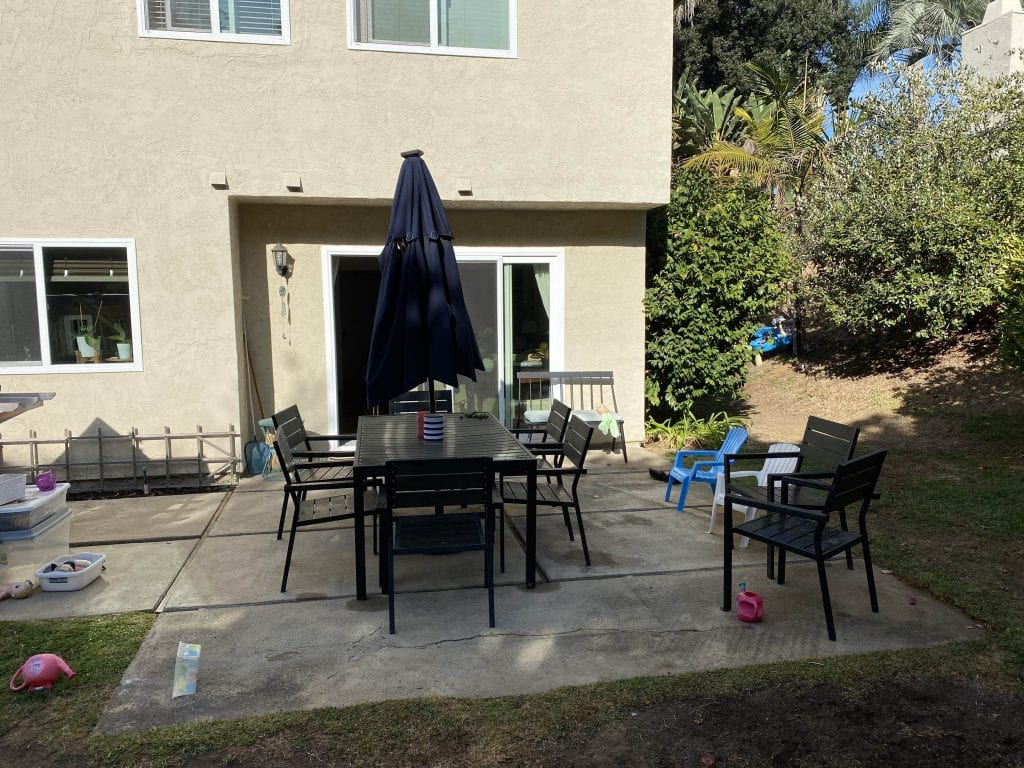 Backyard Patio before outdoor string lights DIY project